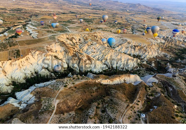 Cappadocia Turkey 09 16 2017: Hot air balloons over the rocks and empty blue sky