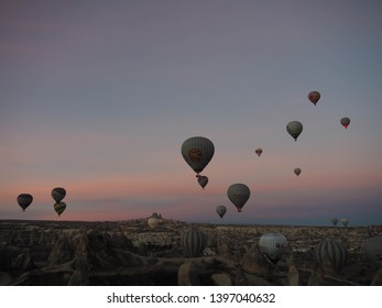 Cappadocia, Turkey, 12 February, 2019:  The Turkish earth landscape is surrounded by hot air balloons.