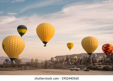 Cappadocia Turkey, 22-11-2019: Flying Hot Balloons in Sunrise. Picture contain selective focus.