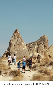CAPPADOCIA, TURKEY - AUGUST 24: People visiting special stone formation at Zelve Valley in Cappadocia on August 24, 2013 in Nevsehir, Turkey. Cappadocia is part of the UNESCO World Heritage Site.