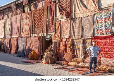 Göreme, Cappadocia, Turkey - JUL 1, 2008 - Saleman with carpets