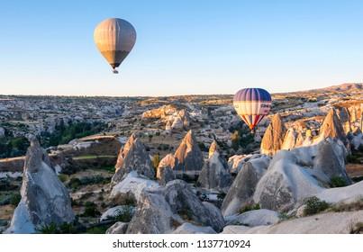 Cappadocia, Turkey - July 05, 2018 : Hot Air Balloons are taking off durşng sunrise in Cappadocia Region of Turkey.