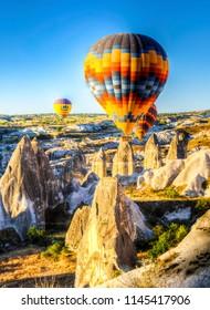 Cappadocia, Turkey - July 05, 2018 : Hot Air Balloons are flying during sunrise in Cappadocia Region of Turkey.