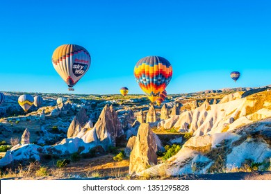 Cappadocia, Turkey - July 05, 2018 : Hot Air Balloons are taking off during sunrise in Cappadocia Region of Turkey.
