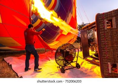 CAPPADOCIA, TURKEY - JULY 29, 2017: Hot air Balloons and pilot in Cappadocia, Nevsehir, Turkey in a beautiful summer day
