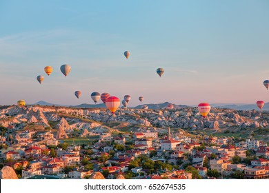 CAPPADOCIA, TURKEY - JUNE 03, 2017: Hot air balloons flying over rock landscape at Cappadocia Turkey