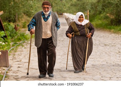 CAPPADOCIA, TURKEY - JUNE 15: Turkish couple walks along stone path on June 15, 2011 in Cappadocia, Turkey