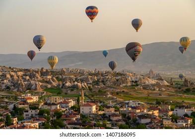 CAPPADOCIA, TURKEY - MAY 04, 2018: Hot air balloon flying over rock landscape at Cappadocia Turkey