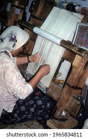 CAPPADOCIA TURKEY - MAY 15,  2002 - Woman weaving a carpet on hand loom, Cappadocia, Turkey