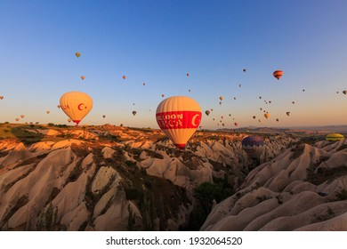 Cappadocia, Turkey; May 2018: Flying at sunrise with hundreds of  brightly colored balloons that float above Cappadocia.