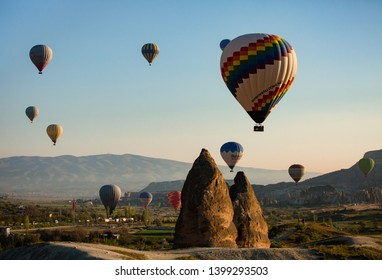 Cappadocia, Turkey, May 2019: early morning sunrise hot balloon spectacle  over the ancient town of Goreme