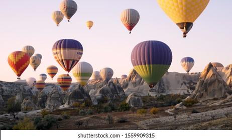 Cappadocia, Turkey -October, 2019: Colorful hot air balloons flying over the valley at Cappadocia