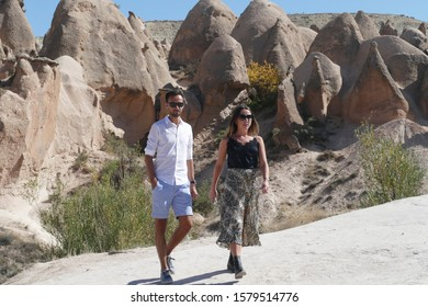 CAPPADOCIA, TURKEY - SEP 11, 2019 - Tourists explore fairy chimney balanced rock formations near Devrent, Pasabaglari, Cappadocia, Turkey