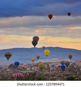 Cappadocia / Turkey - September 13 2016 : Hot air balloons at sunrise