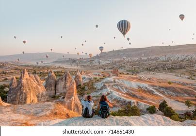 CAPPADOCIA, TURKEY - SEPTEMBER 13, 2017: Hot air balloon flying over rock landscape at Cappadocia Turkey