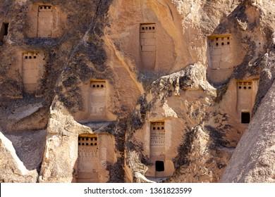 Cappadocia, Turkey, September 13, 2018: Tourists looking at the ancient church, the largest rock-cut monastery of Cappadocia, Turkey