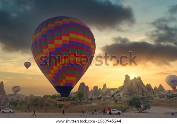 Cappadocia, Turkey - September, 2019: Hot air balloon flying over spectacular Cappadocia. Hot air balloon flying over spectacular Cappadocia
