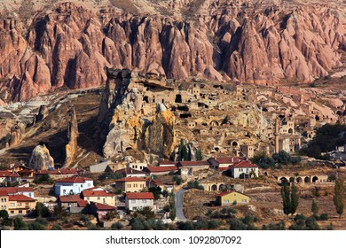 CAPPADOCIA, TURKEY. View of the village and the old troglodyte settlement of Cavusin (above), where you can see the oldest rock cut church in the region.