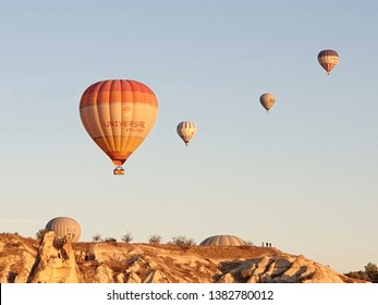 Cappadocia,Turkey-Circa October 2018: Balloons fly up into the sky above the rocky hills in early morning in Cappadocia where is the dream destination for travelers.