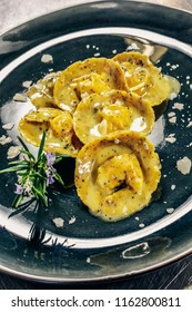 Cappelli del prete (hats of the priest): kind of homemade stuffed  fresh pasta. Dressing are made of butter, sage and rosemary.