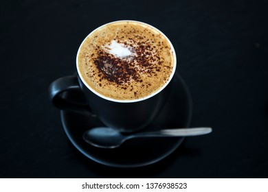 Cappuccino in the black cup
