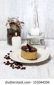 Cappuccino cake on white plate. Selective focus