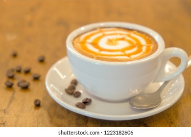 Cappuccino coffee with caramel syrup