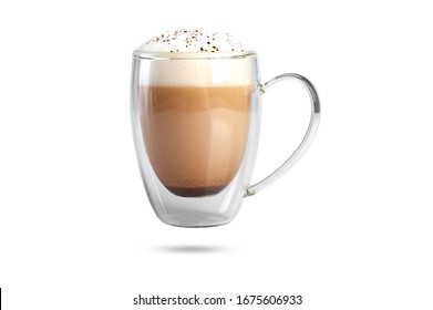 cappuccino with cinnamon on a foam in a transparent cup with a double bottom. isolate on white background