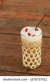 Cappuccino in a clear glass decorated with bamboo weaves