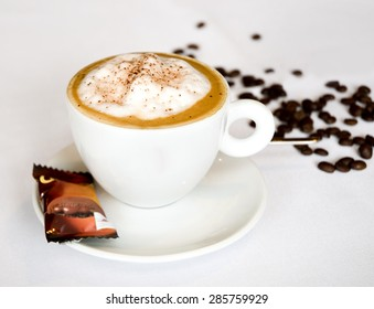 Cappuccino coffee with beans on a table in restaurant