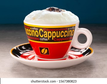 cappuccino coffee, a caffeinated hot Italian-style drink with milk foam and cocoa powder.