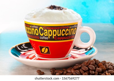 cappuccino coffee, a caffeinated hot Italian-style drink with milk foam and cocoa powder. with whole coffee beans on the table
