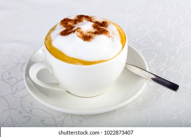 Cappuccino coffee with choco star