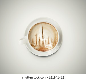 Cappuccino coffee. A cup of latte, cappuccino or espresso coffee with milk put on a white table. with Dubai skyline drawing the foam milk on top.