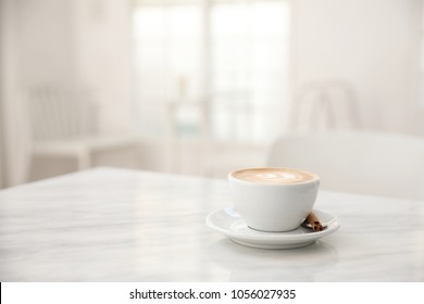Cappuccino coffee cup on white marble table
