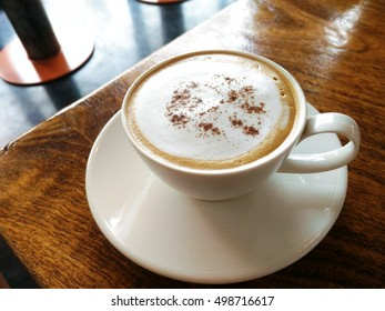 cappuccino coffee / coffee drink that is traditionally prepared with double espresso, hot milk, and steamed milk foam /