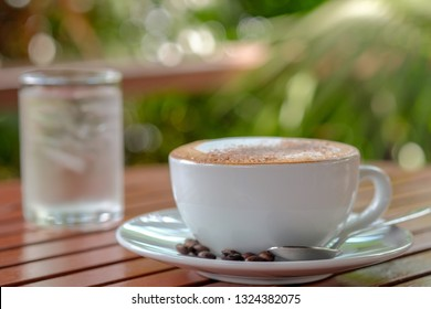 Cappuccino coffee and morning light background