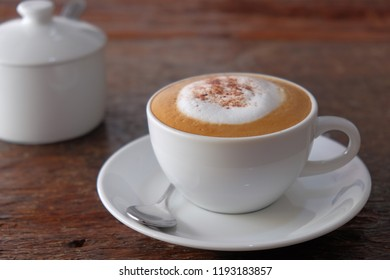 Cappuccino coffee on vintage wooden table