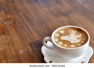 Cappuccino coffee on wood table. Cappuccino deer topping.