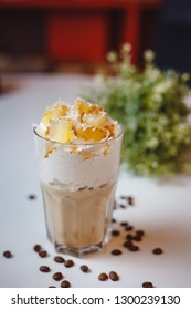 Cappuccino with cream and tangerine slices