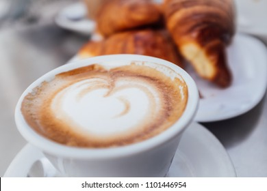 Cappuccino and croissants for breakfast in Italy
