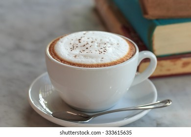 Cappuccino cup with book