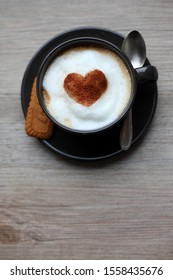 cappuccino in a cup with zinniamon heart
