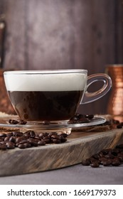 Cappuccino is an espresso-based coffee drink and steamed milk foam made from coffee in a transparent glass cup. Hot coffee with steam.