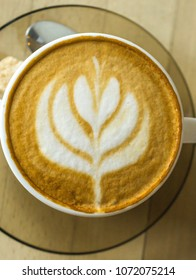 Cappuccino with a flower shape formed from the foam.