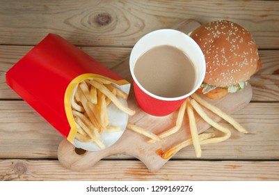 Cappuccino in glass, french fries and hamburger, take away food set, fast food and snacks concept