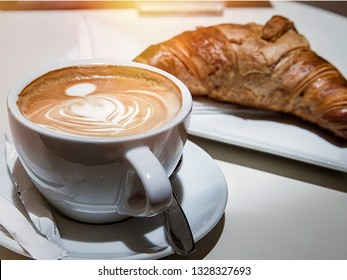 Cappuccino Latte. Breakfast with coffee and croissant. Stock Image.