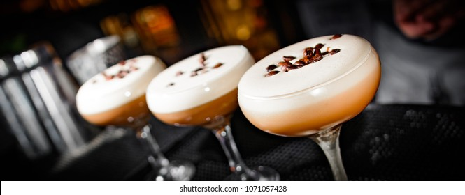 Cappuccino martini being made at a bar