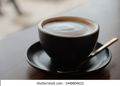 Cappuccino coffee​ on wooden and morning light​