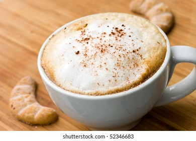Cappuccino and Sweet Cookies on the wooden Background